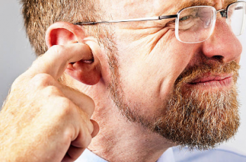 A patient wants to know how to remove excess earwax