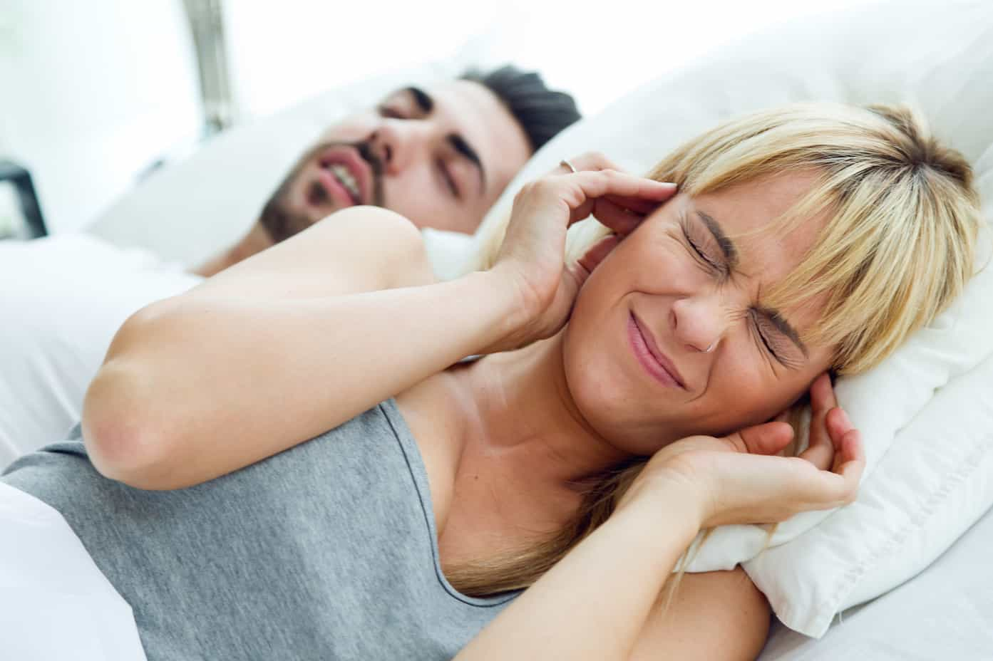 Young woman who can not sleep because her husband snores
