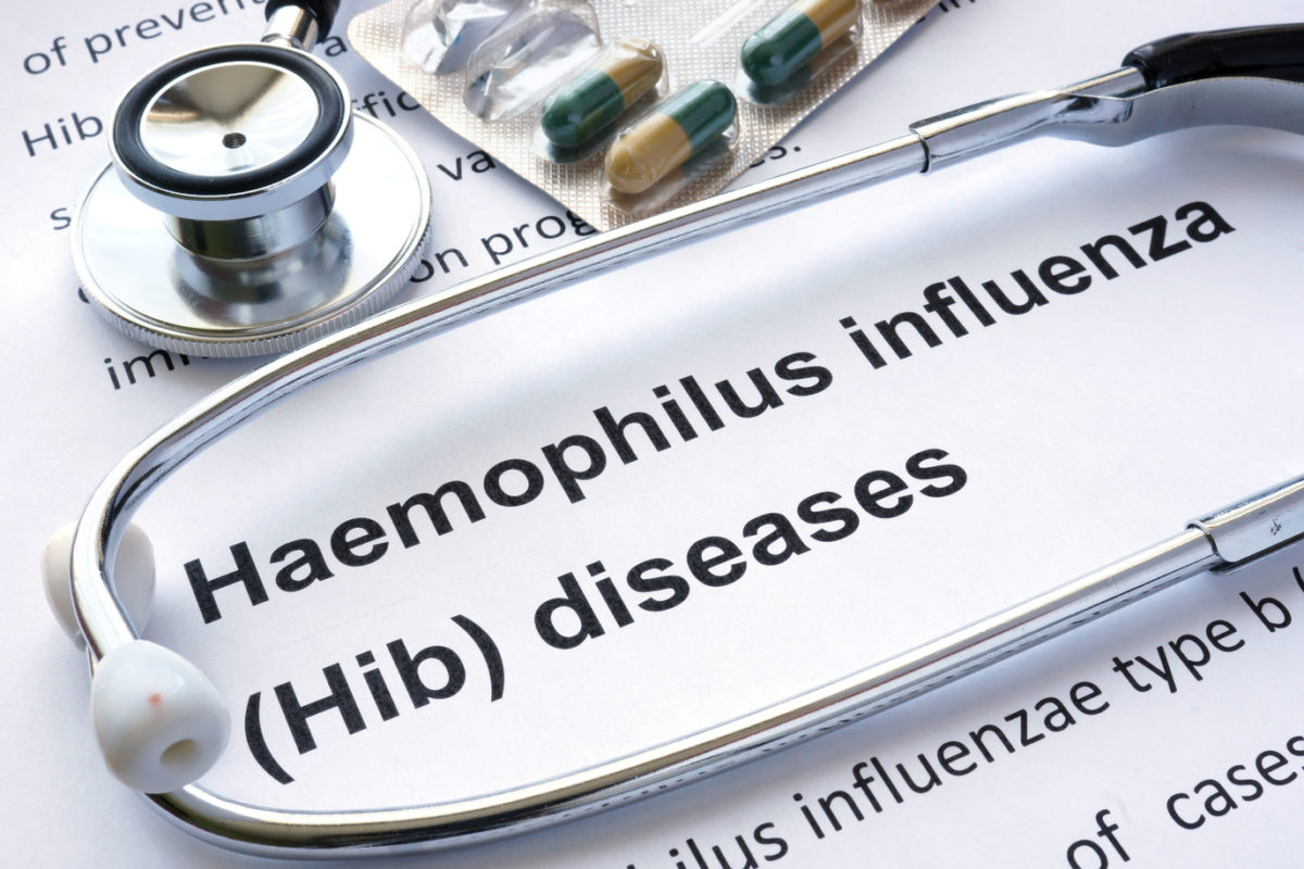 Paper with diagnosis Haemophilus influenza (Hib) diseases and stethoscope.